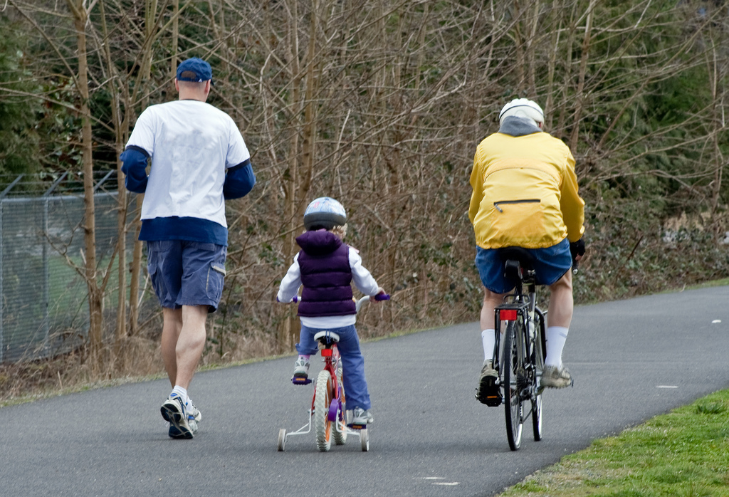 Bicycle & Jogger with child ride along the bike path